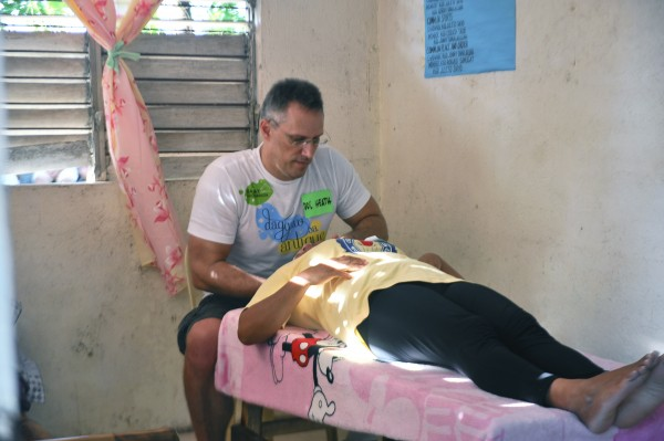 Dr. Heath Motley of the United Nations Chiropractic Center-Manila treated Janlagasi residents in the one-room barangay hall.
